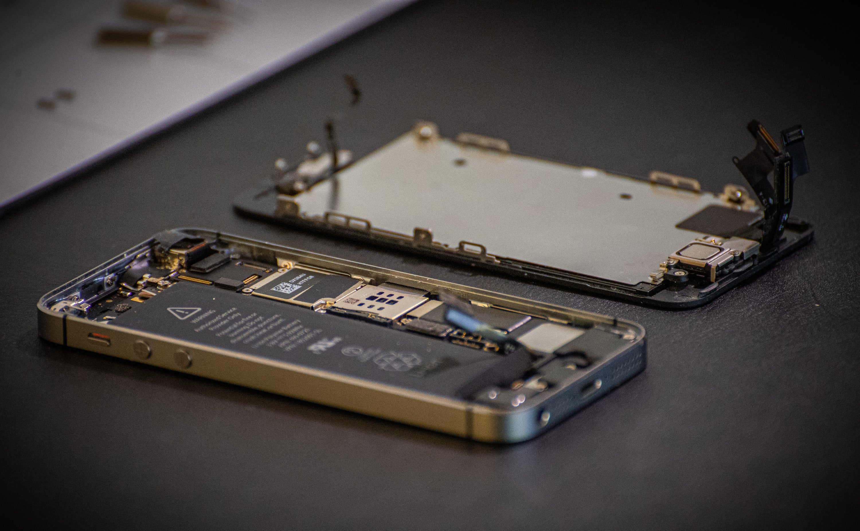 An iPhone under repair.